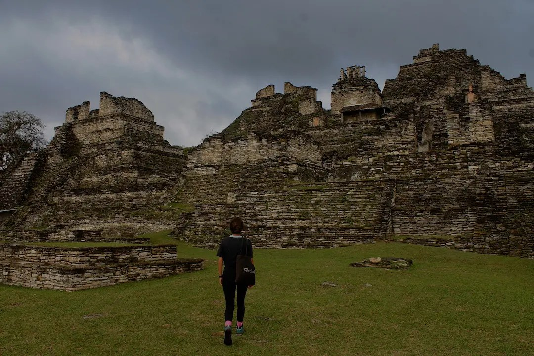 A girl walking through the ancient ruins of Tonina one of the ruins in Chiapas on her road trip in Chiapas