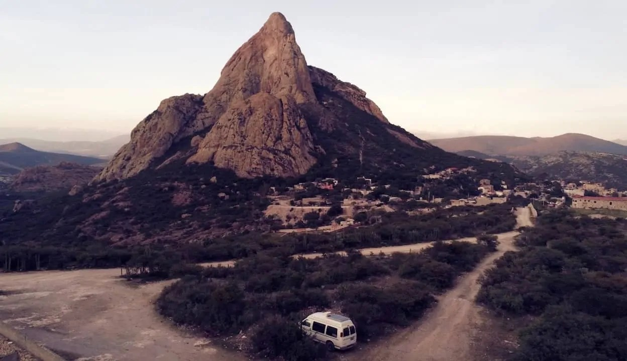 The van parked at our campsite overlooking the monolith of Bernal