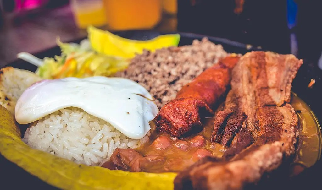 Bandeja Paisa includes meat, beans, rice, an egg, avocado and more and is one (if not the) best Colombian foods