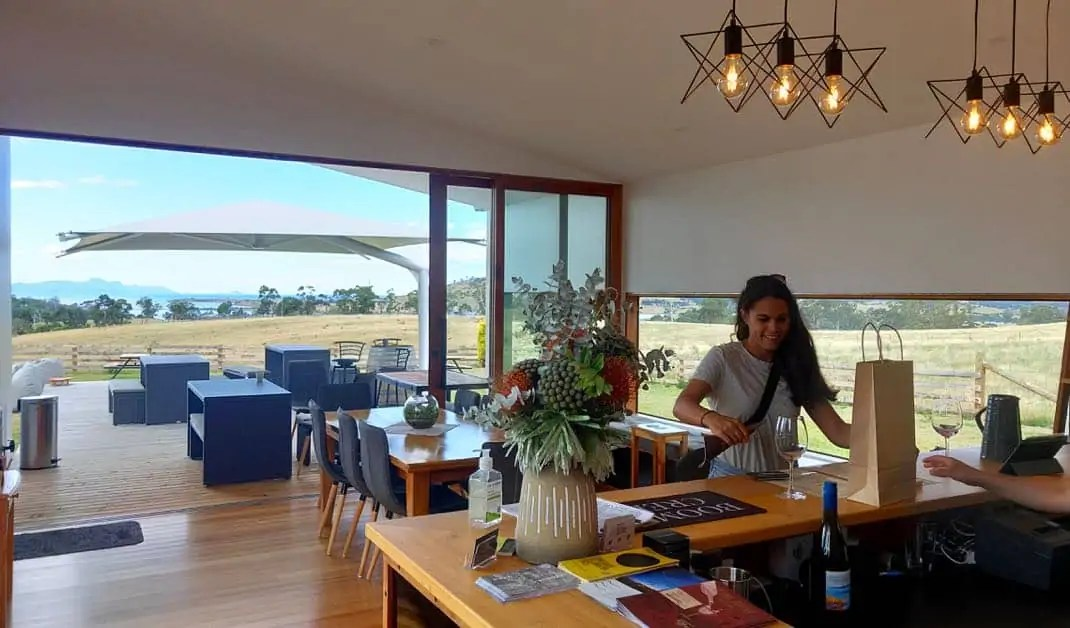 Kelli purchases some wine at Boomer Creek Winery on the Great Eastern Drive, Tasmania