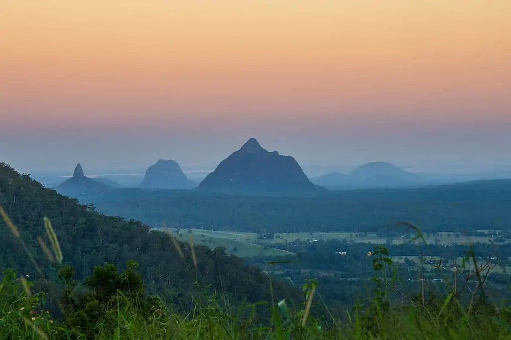 A picture of the glasshouse mountains at sunset. One of the best national parks near Brisbane.
