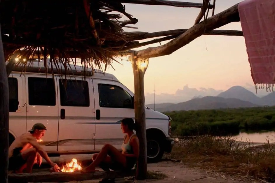 Two people camping on a beach in Mexico. Is it safe to drive through Mexico?