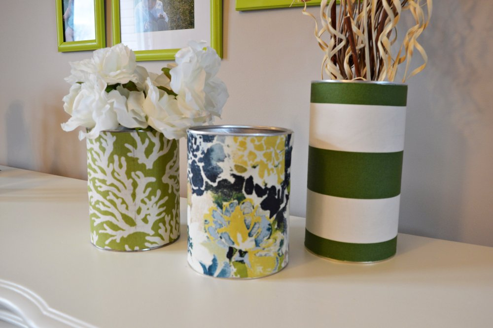 Formula can vases with blue and lime fabric. Make this colorful tin can vase with fabric and mod-podge