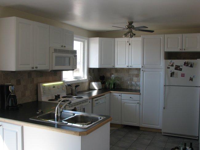 White kitchen with travertine backsplash