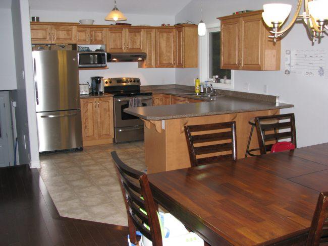 Open concept maple kitchen