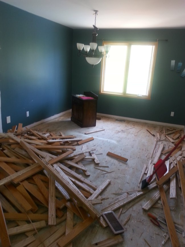 living room renovation with new hardwood flooring