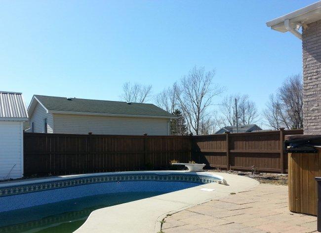 Wood fence around a pool