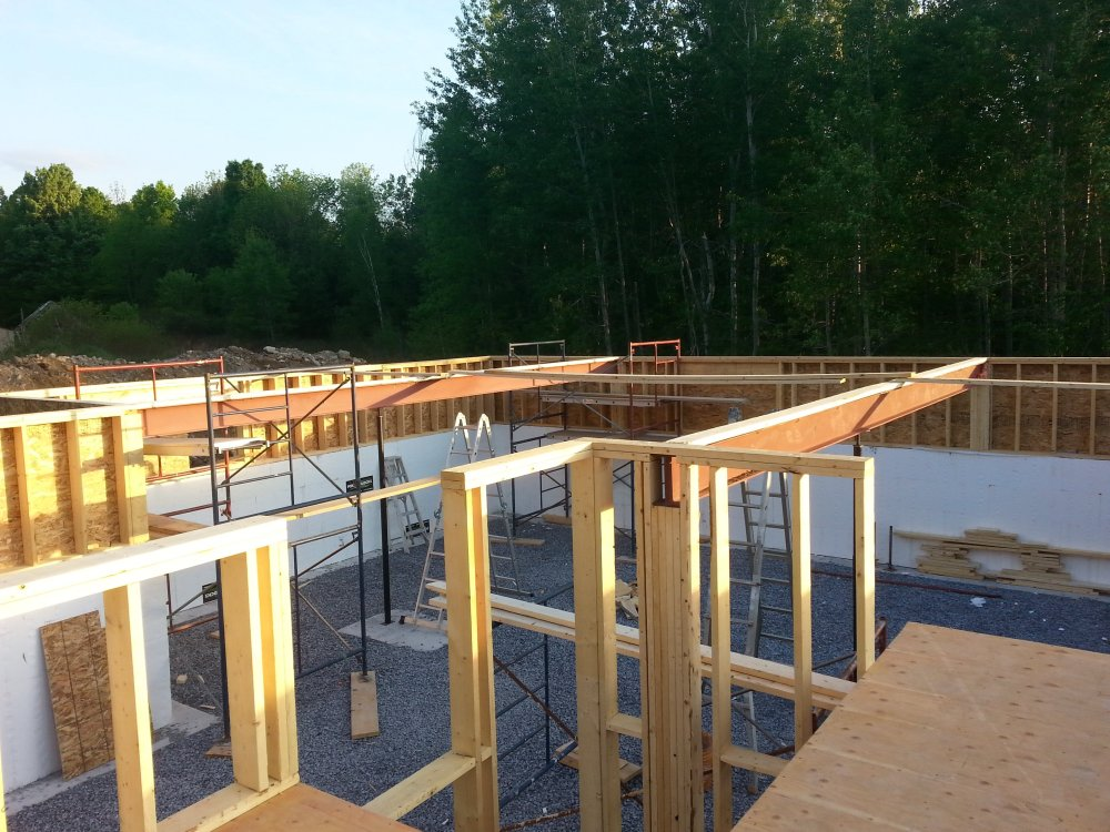 steel beam and floor joists. Owner builder raised bungalow