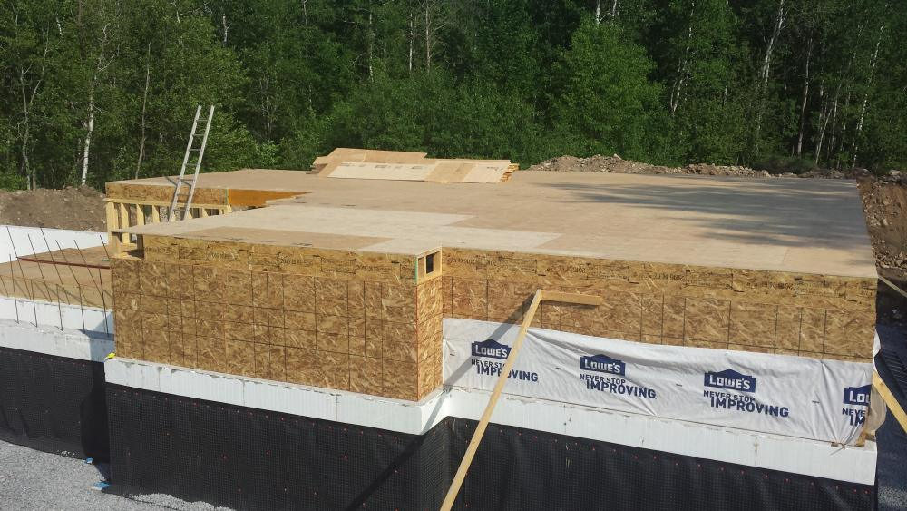 Intalling the subfloor on floor joists