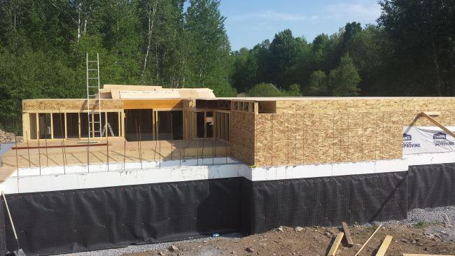 Steel beams, floors joists and subfloor. Owner builder raised bungalow in Ontario