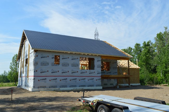 Vicwest black tin roof. Owner builder raised bungalow in Ontario
