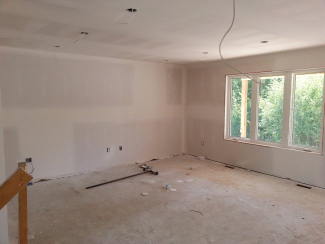 living room new drywall stage of construction