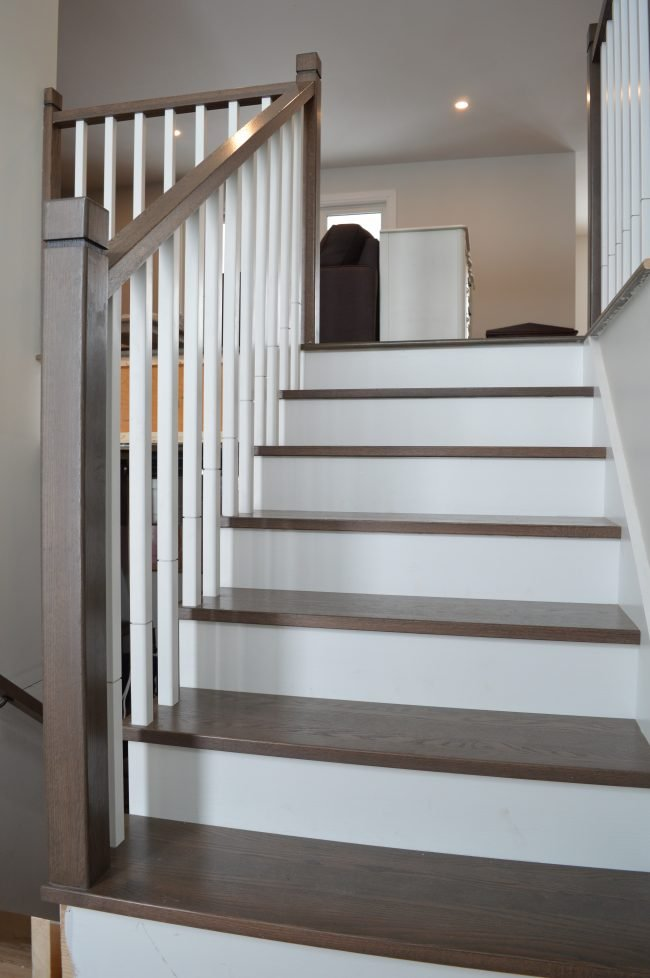 dark wood stairs with white risers and square spindles