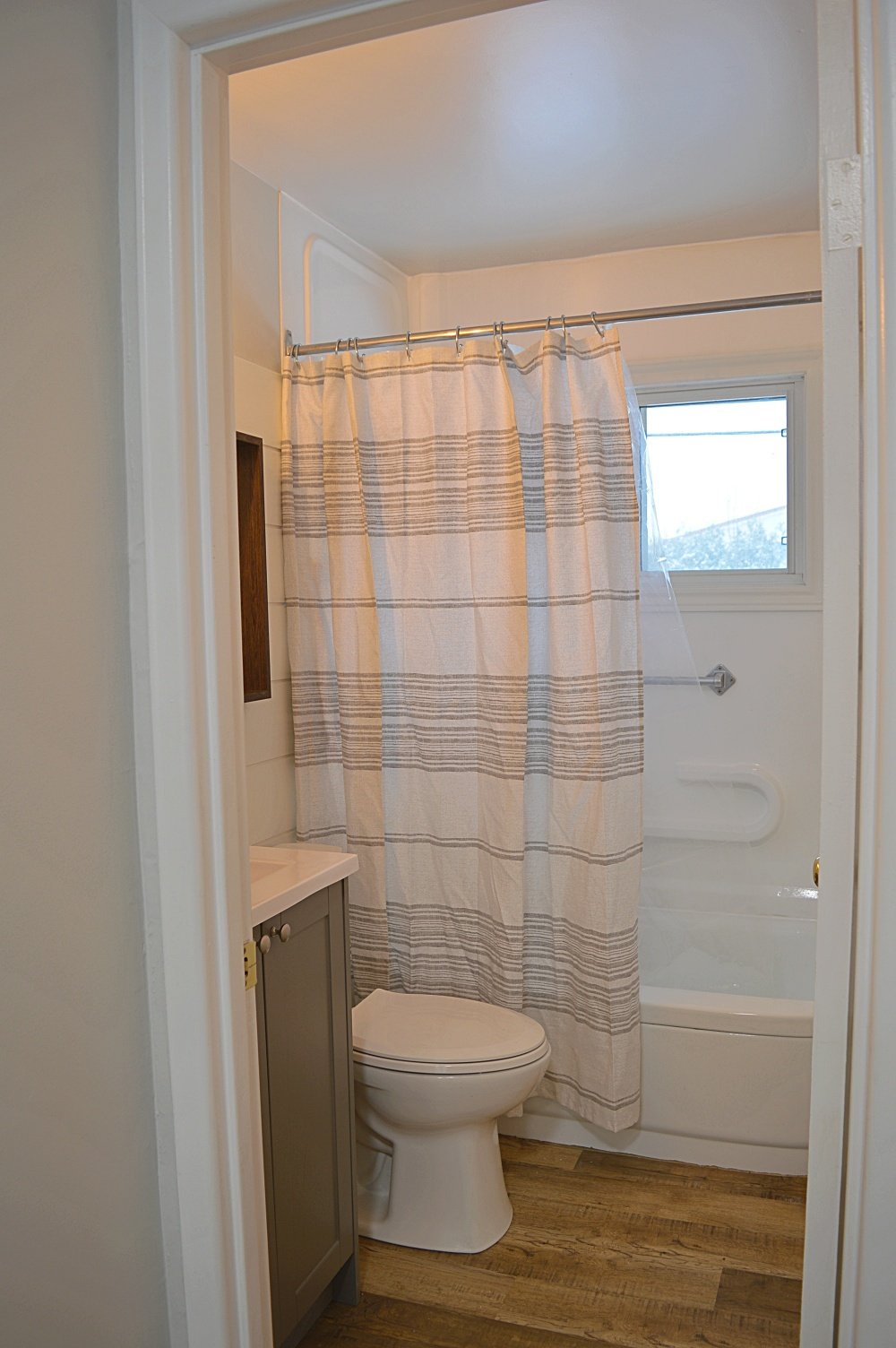 rental property renovation grey and white bathroom renovation