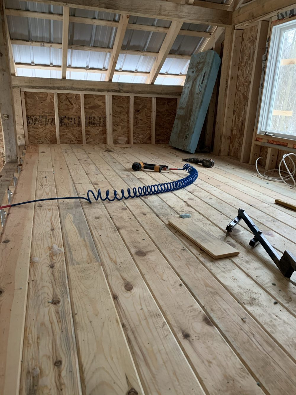 cabin loft with pine flooring