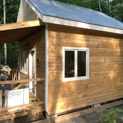 Finished wood cabin exterior, more kitchen progress, and some furniture