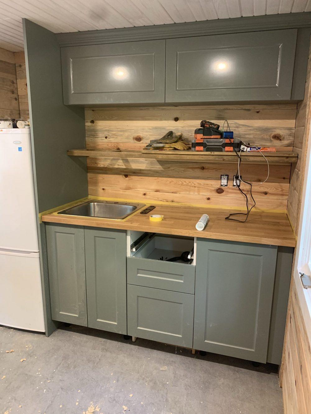 tiny house green kitchen