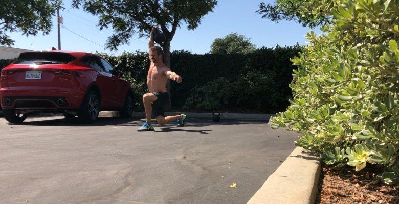 Joe Bauer does Parking lot overhead lunges