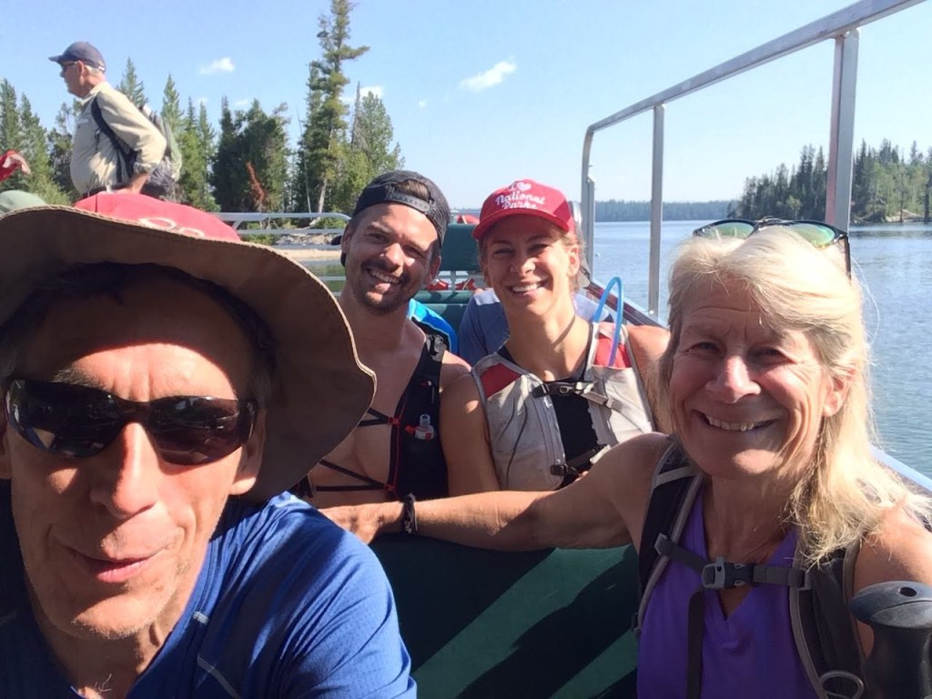 Chuck, Joe, Emily, and Sue on Jenny Lake boat headed to lake Solitude