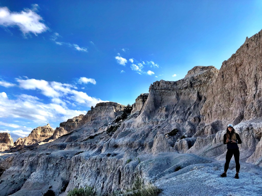 Emily Hiking Badlands National Park van life