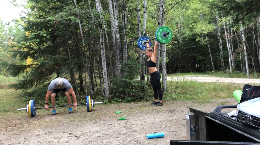 Joe and Emily lifting weights at the Woodenfrog campground near Voyageurs National Park