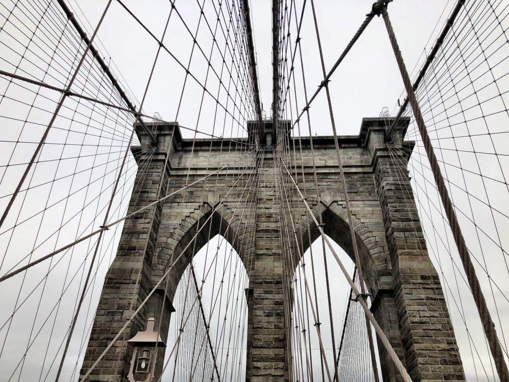 Brooklyn Bridge cables with gray sky