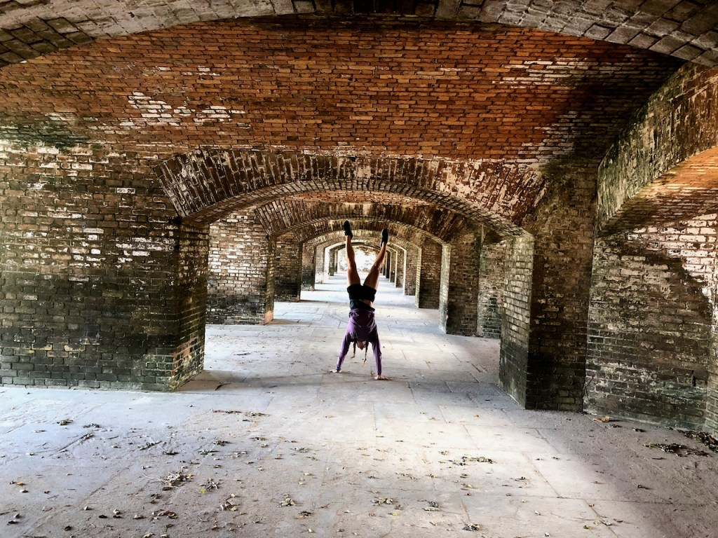 Emily handstand walking through Dry Tortugas National Park