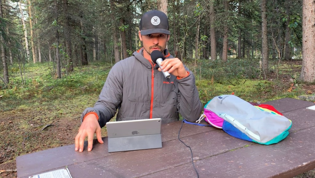 Joe working from the road at a picnic table in Alaska.