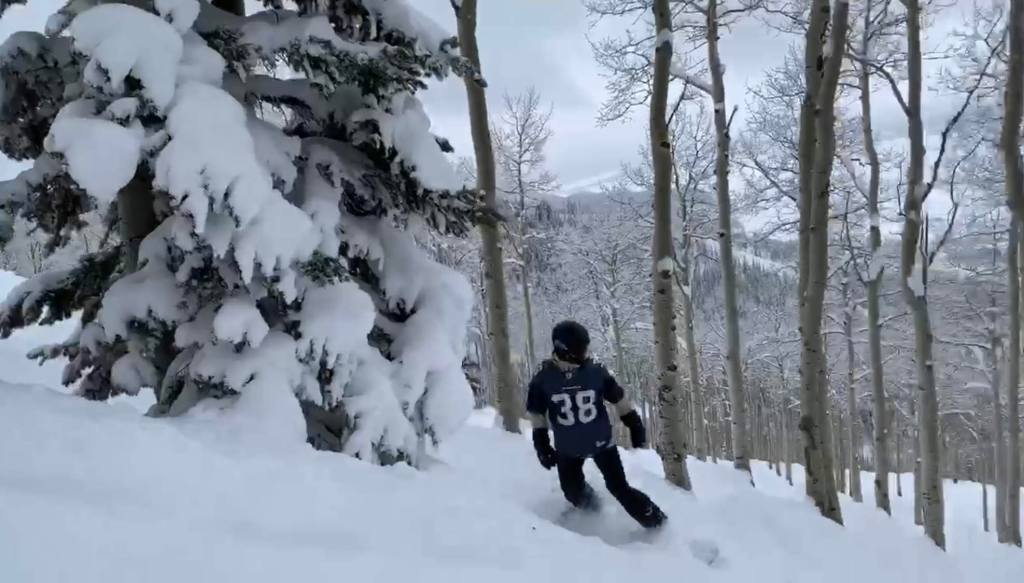 Joe snowboarding at Steamboat Springs on IKON pass with Seahawks jersey on