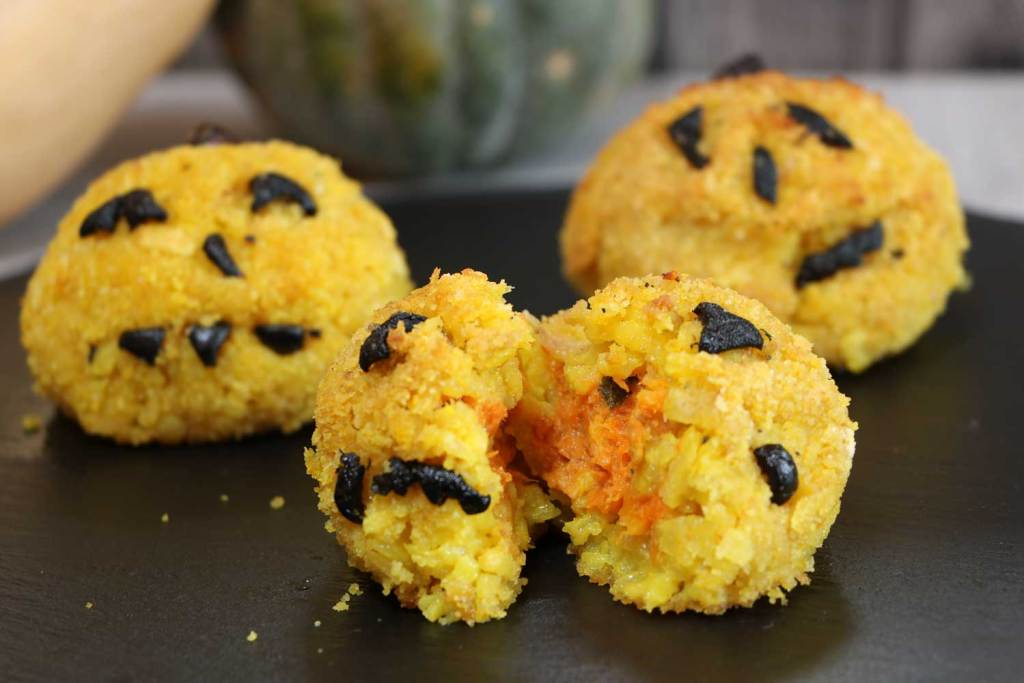 Jack O' Lantern Risotto Balls showing their insides