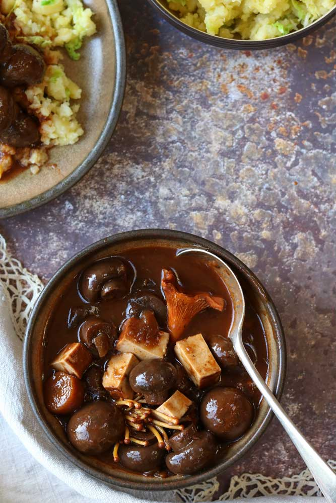 Mushroom and Tofu bourguignon with mash on table