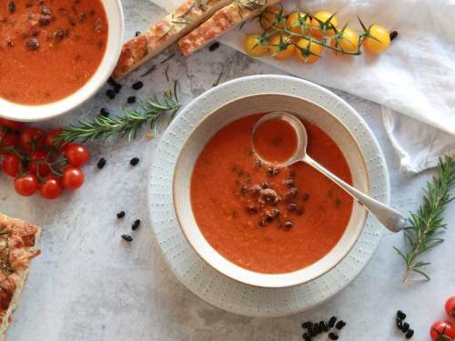 Roasted Tomato and Black Bean Soup with a spoon on the table