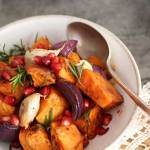 Harissa Spiced Roasted Roots with rosemary & pomegranate with spoon on a plate