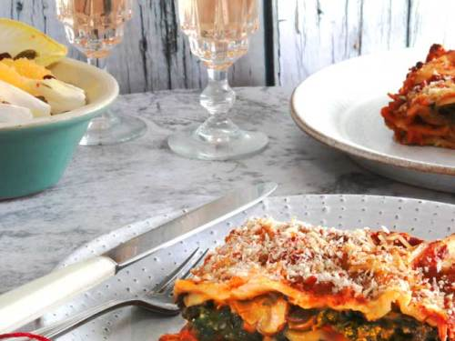 Vegan lasagne with mushroom and kale on a plate