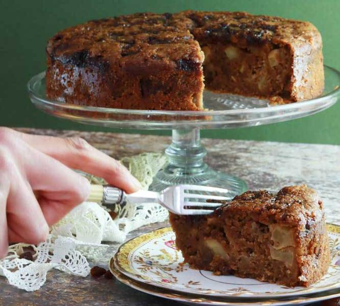 Apple Cake on stand with piece of cake in front