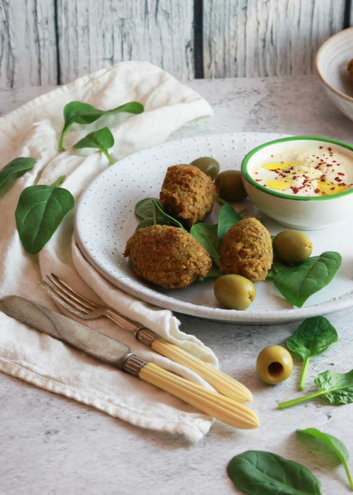 Herby Falafel with hummus dip on a plate