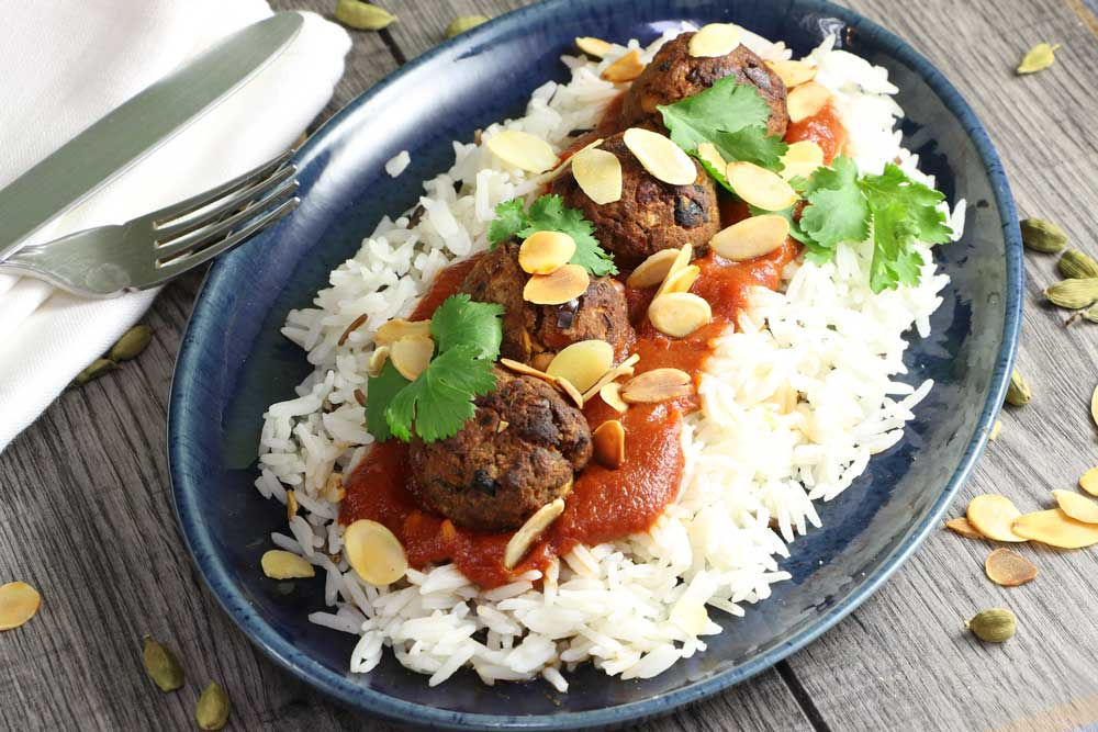 Moroccan Meatless balls on rice with cutlery