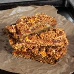 Apricot and Date Layer Bars in a pile on a tray