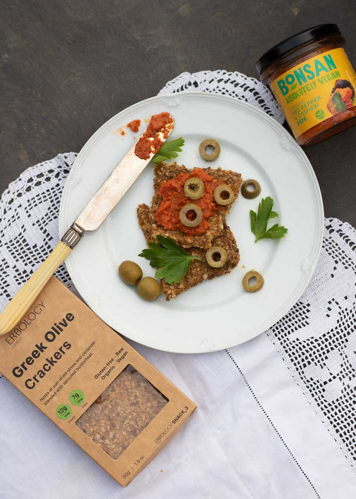 Erbology raw crackers with delicious Bonsan vegan pate on a plate with some extra olives