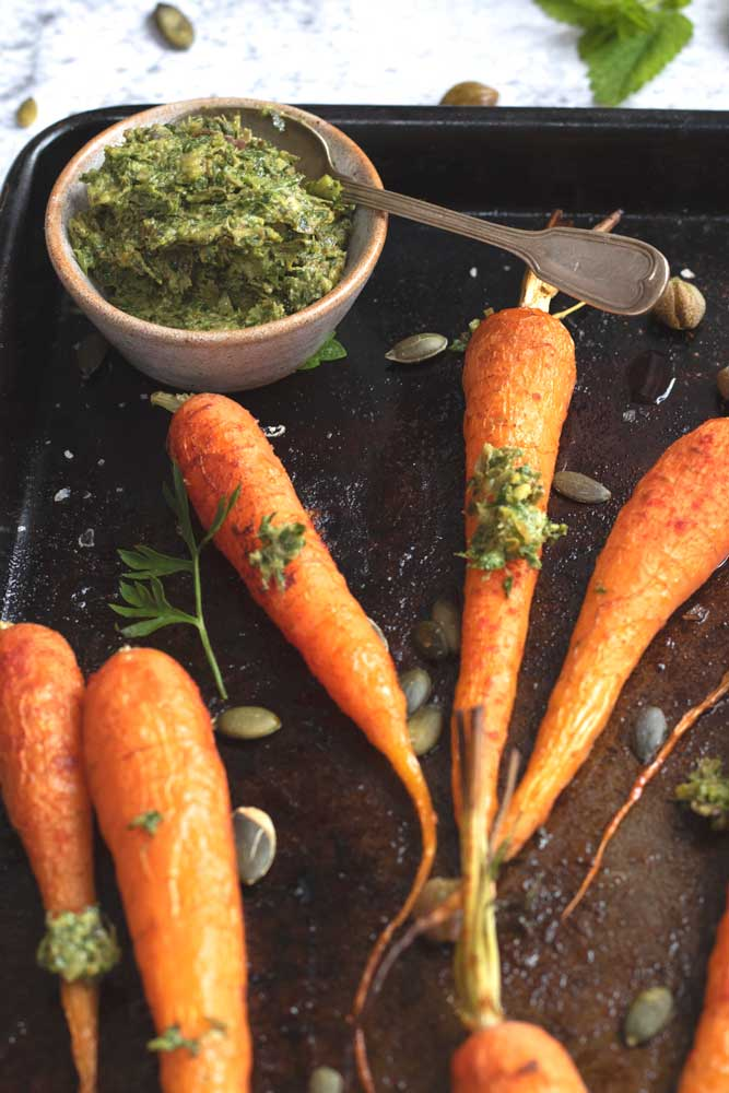 Carrots with Carrot Top Salsa Verde on a tray