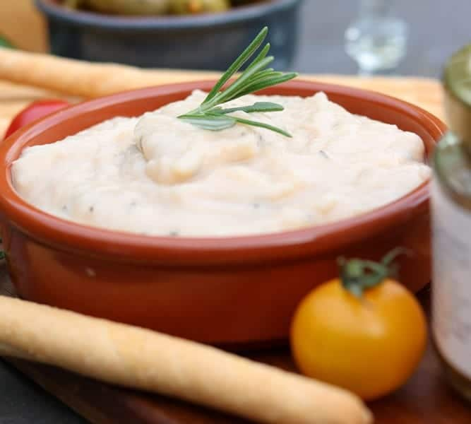 White bean and rosemary dip in a bowl
