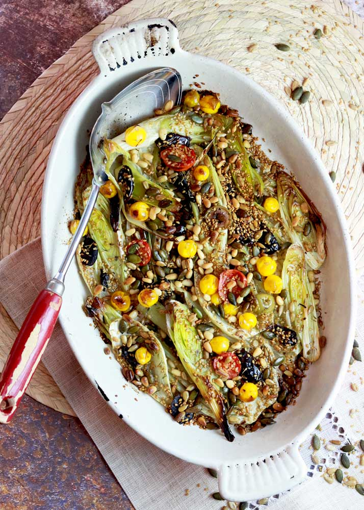 Fennel and leek gratin with a serving spoon in a dish