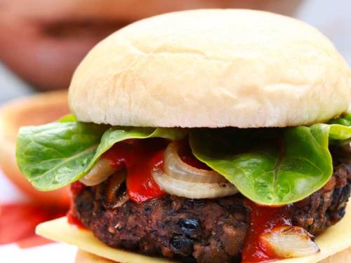 The Ultimate Vegan Blackbean & Mushroom Seitan Burger on a bun