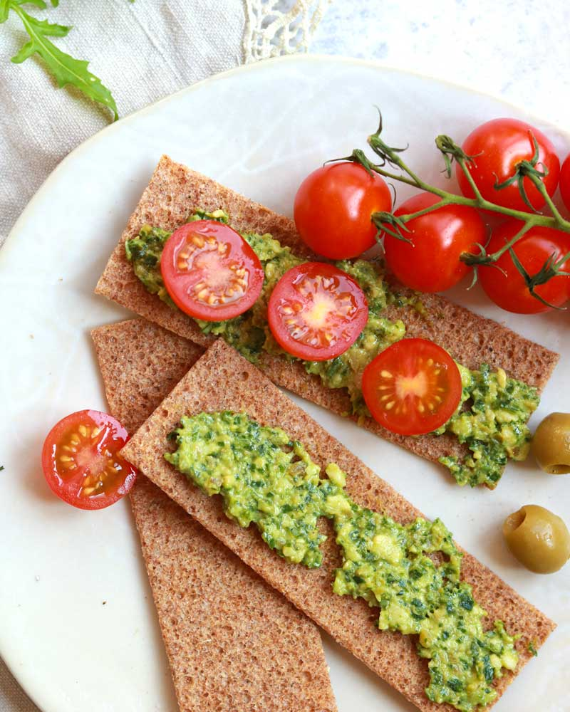 Chunky Rocket, Olive & Cashew Pesto dip on crackers
