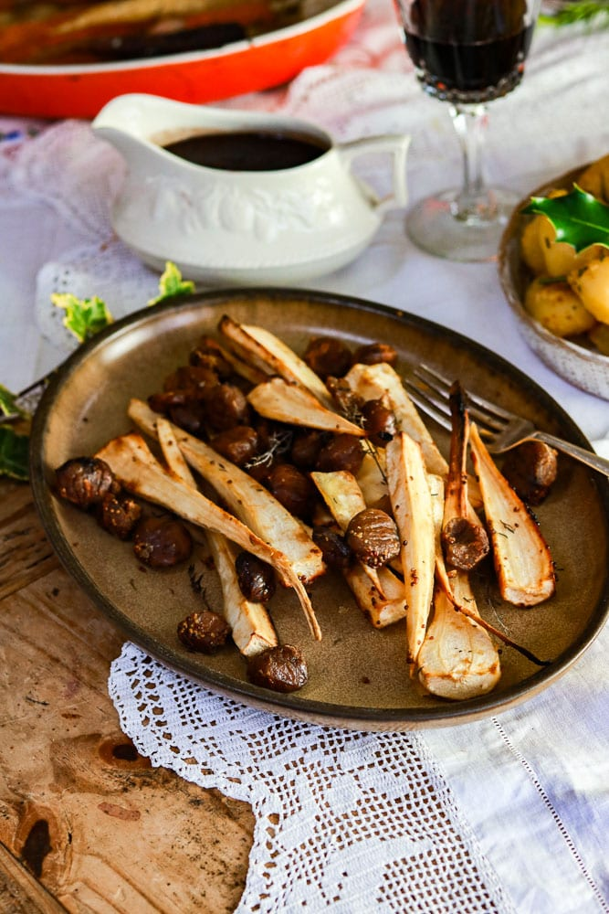 roasted parnsips with chestnuts on a plate