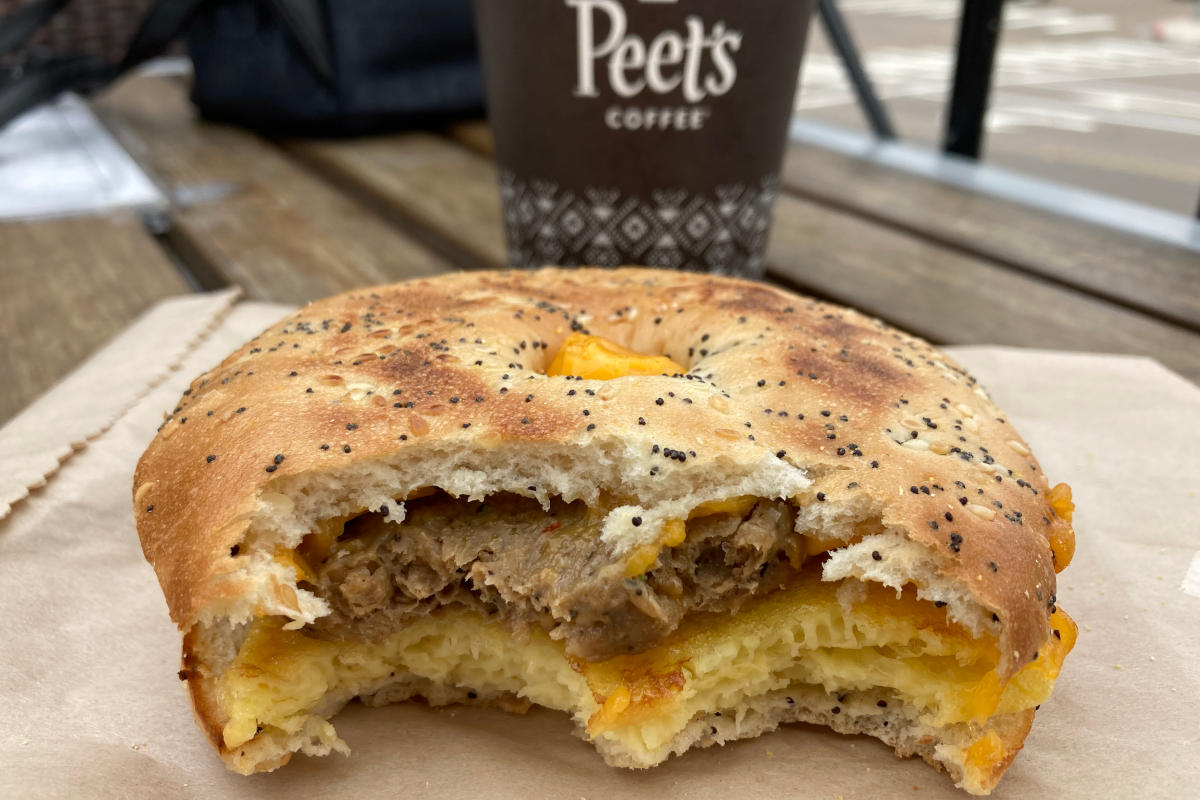 Peet's vegan breakfast sandwich after two bites with vegan cheese, beyond sausage, and just egg.