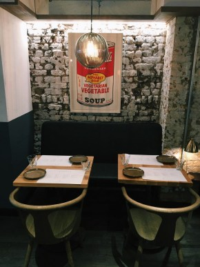 Foley's seating with poster of Campbell's soup can
