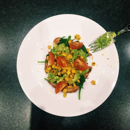 avo on toast with spinach, corn and tomatoes
