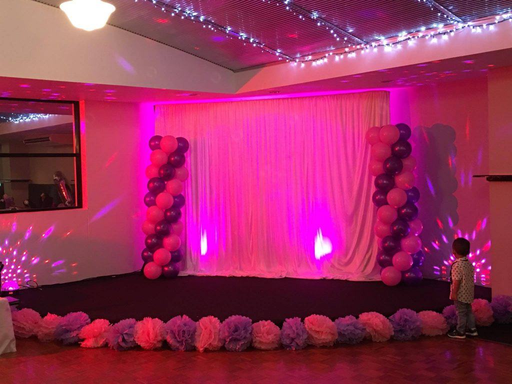 Corner stage decorated with pink lighting for a private function at Darwin