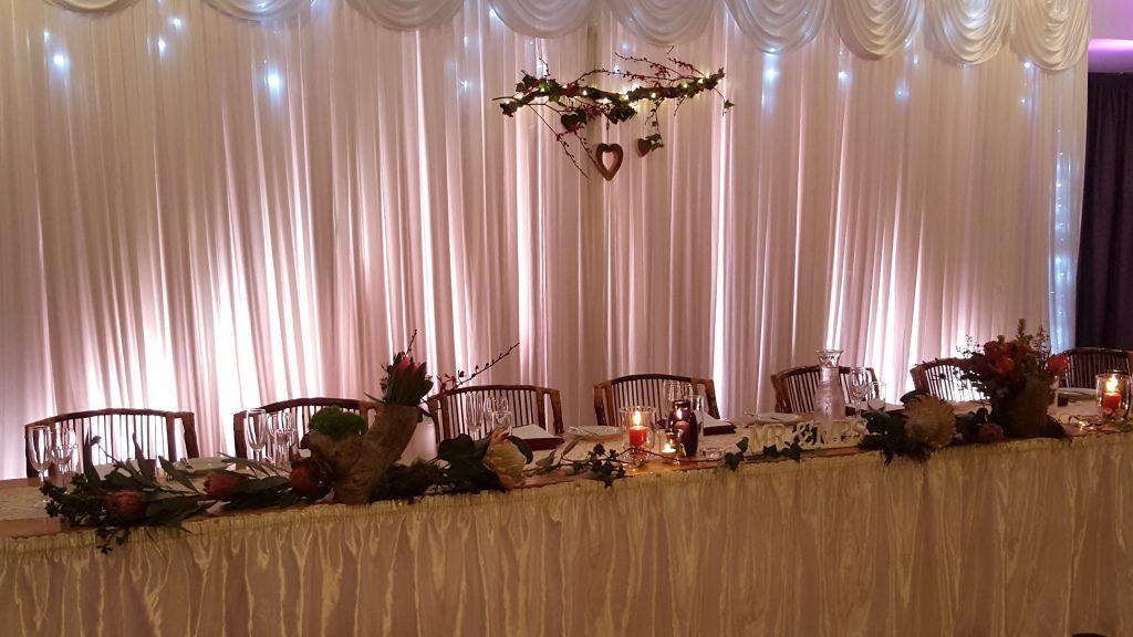 bridal table; rustic; indoor; backdrop; fresh flowers; white wedding; fannie bay;